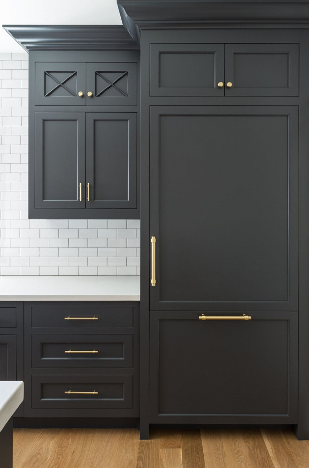 Cheating Heart (Benjamin Moore) dark gray paint color on kitchen cabinets in traditional kitchen by The Fox Group. Come be inspired by more Timeless Interior Design Ideas, Paint Colors & Furniture.  #benjaminmoorecheatingheart #kitchendesign