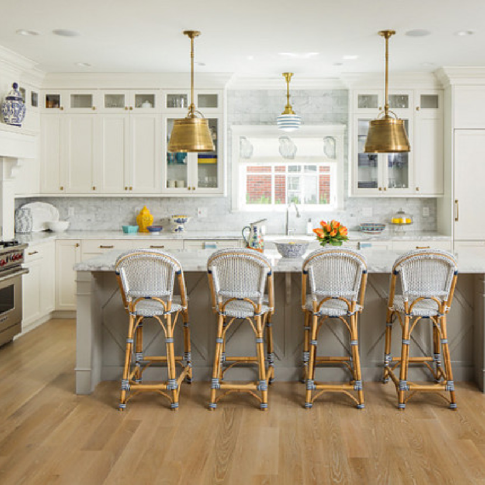 Parisian counter stools in a classic white kitchen with blue accents by The Fox Group. #kitchendesign #timeless #parisian #counterstool #whitekitchen #thefoxgroup