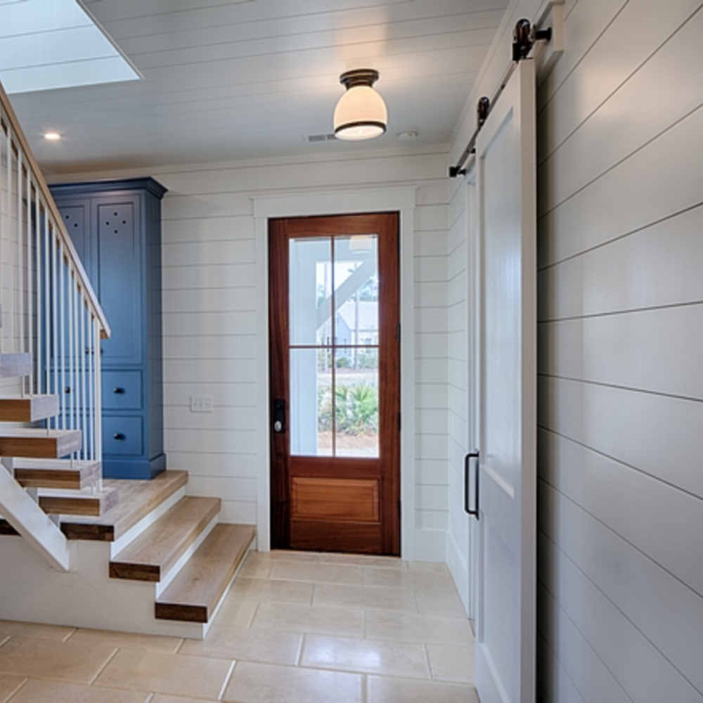 Shiplap walls (painted BM White) in a gorgeous coastal cottage entry with tall blue custom cabinet - come get the details and design resources! #coastalcottage #modernfarmhouse #interiordesign