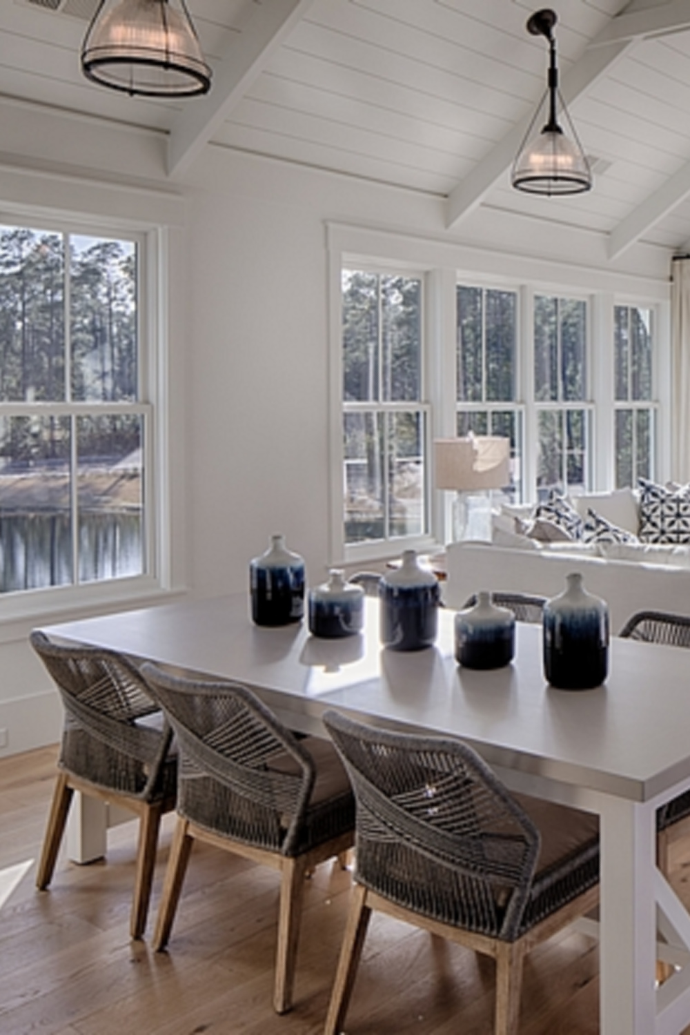 Shiplap on walls and ceilings of a great room in a board and batten coastal cottage by Lisa Furey. #shiplap #greatroom #interiordesign #coastalstyle #modernfarmhouse #benjaminmoorewhite