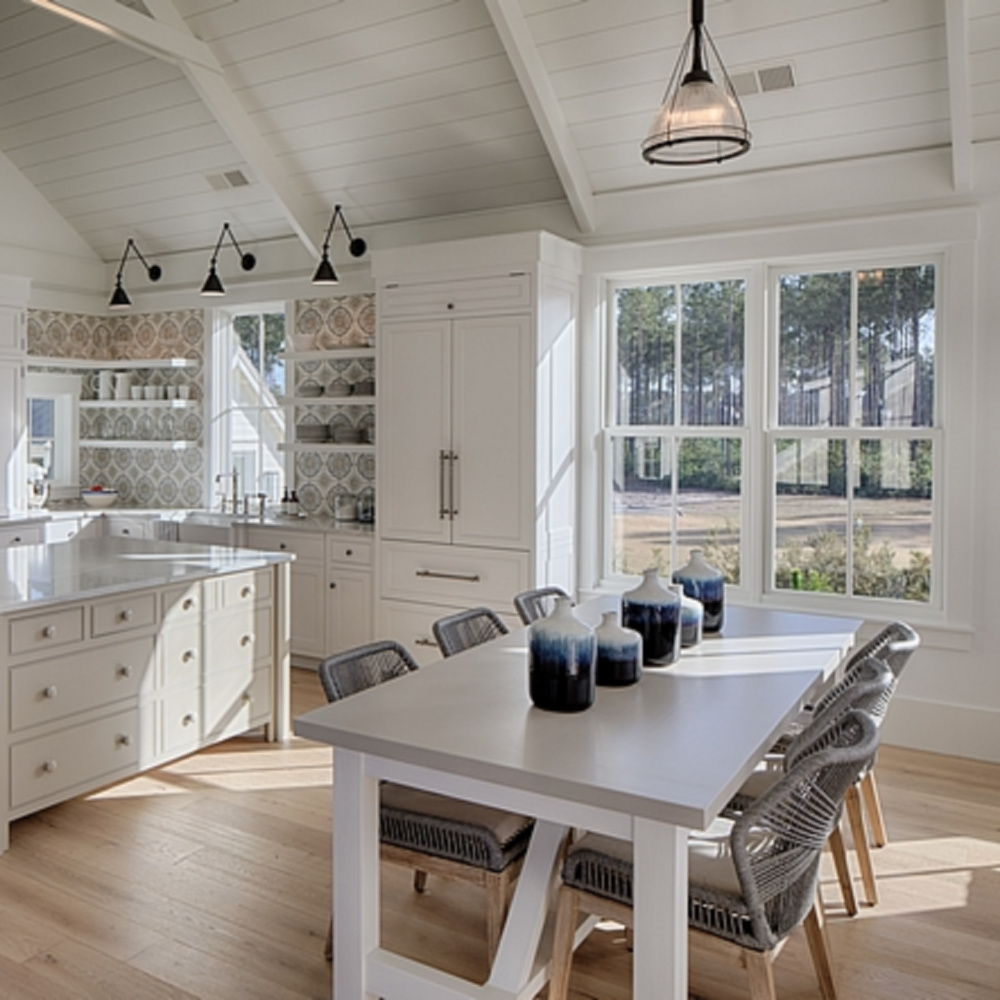 White coastal kitchen with modern farmhouse and Shaker designer elements. Lisa Furey created a welcoming home with shiplap, nods to coastal design, and blue accents. #coastalkitchen #modernfarmhousekitchen #kitchendesign #shiplap #shakerkitchen