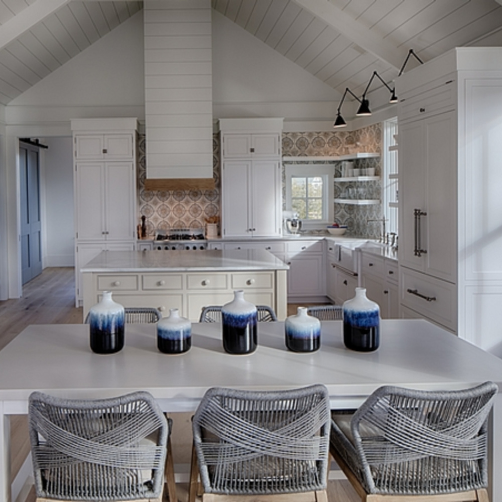 Coastal with modern farmhouse white kitchen in a board and batten coastal cottage in Palmetto Bluff. Lisa Furey designed this beautiful space. #coastalstyle #modernfarmhouse #kitchendesign #interiordesign