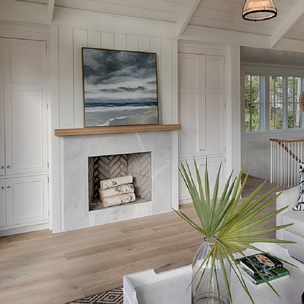 Fireplace in living room flanked by built-ins. Shiplap on walls and ceiling painted Benjamin Moore White. Designed by Lisa Furey. #coastalstyle #greatroom #fireplace #builtins #shiplap