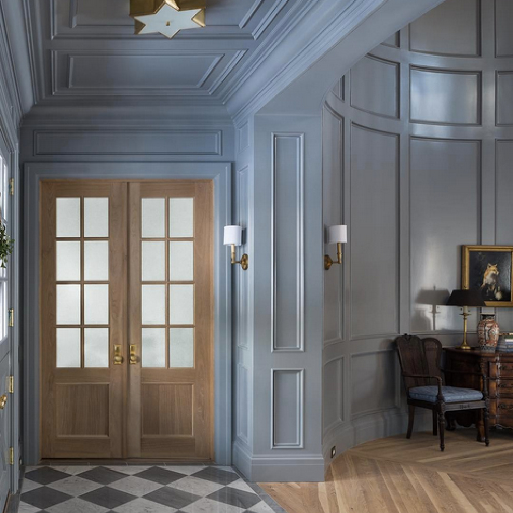 Blue grey painted paneled formal entry with checkered floor in magnificent house by The Fox Group. #bluegray #paneledroom #thefoxgroup #interiordesign #entry #traditional #millwork #architecture