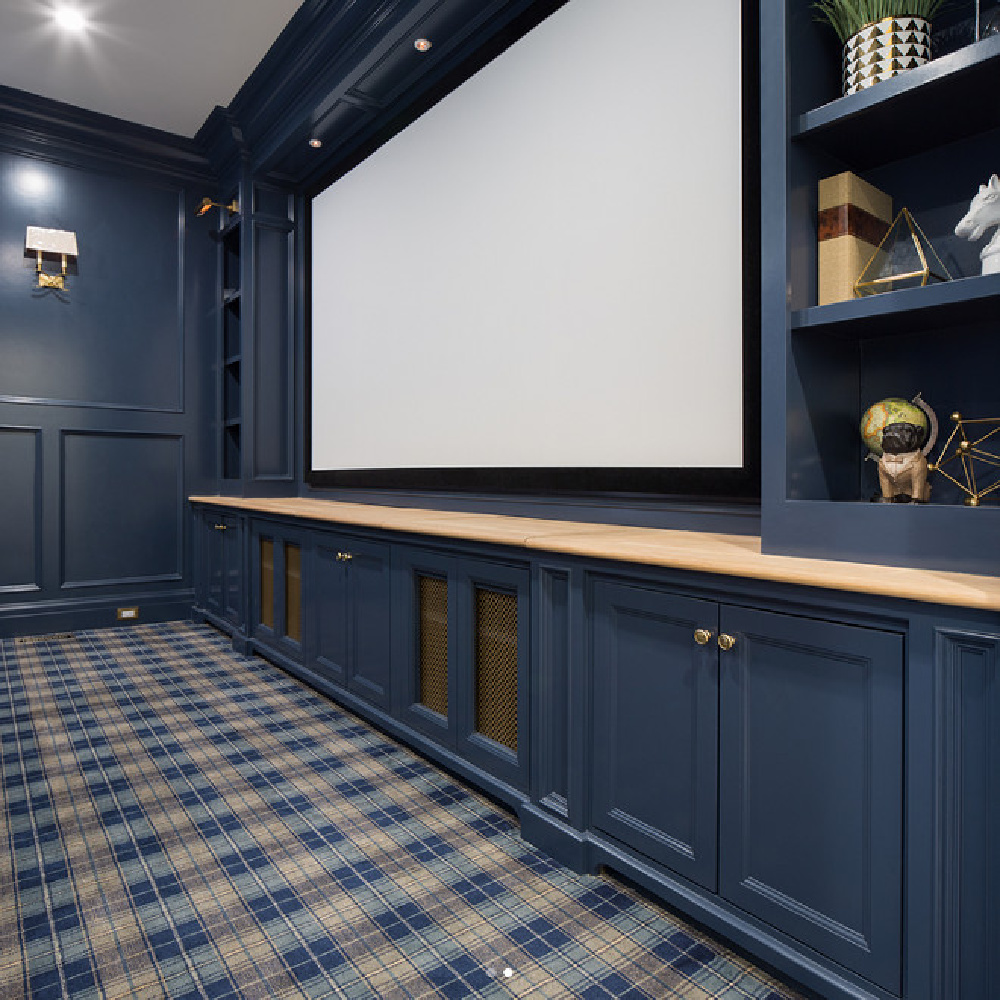 Navy blue painted paneled walls in a magificent media room with plaid carpet by The Fox Group. #navyblue #paneling #mediaroom #thefoxgroup #plaidcarpet