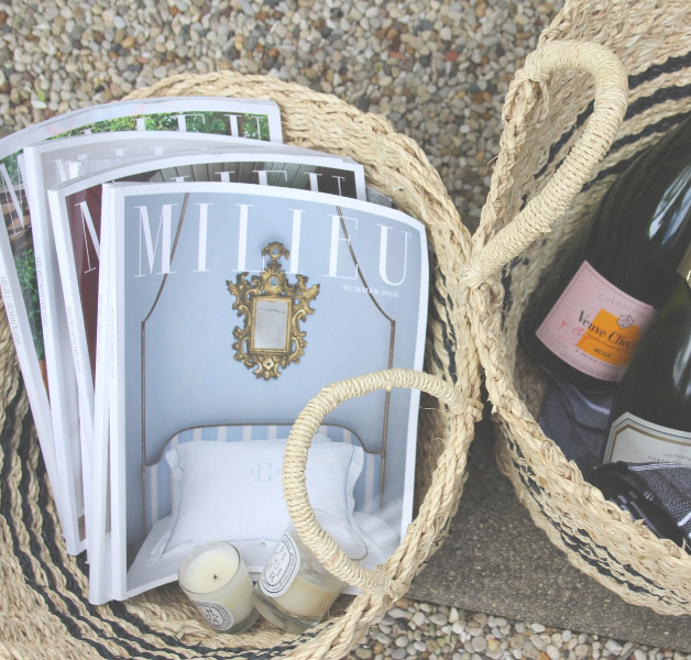 French seagrass baskets in the garden with copies of Milieu magazine and picnic essentials (champagne, Laduree macarons, and a Turkish beach blanket). #hellolovelystudio #milieumoment #seagrassbaskets #frenchbaskets #frenchpicnic #turkishtowel #laduree