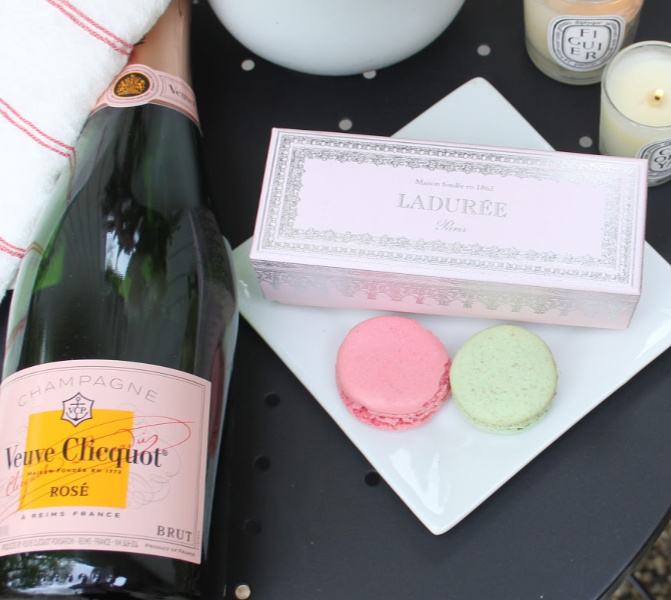 Parisian bliss on a tabletop with Veuve Cliquot pink champagne, Laduree macarons, and linen. #hellolovelystudio #Parisianstyle #veuvecliquot #pinkchampagne #laduree #macarons #pinkbox