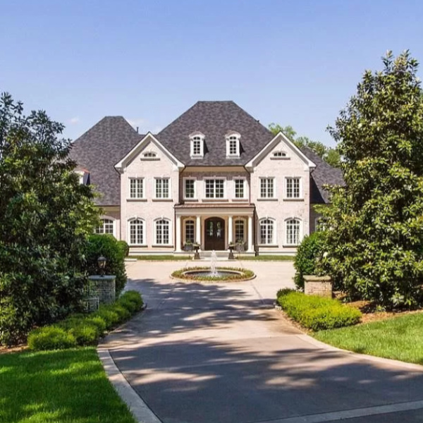 This French chateau exterior is the home of Kelly Clarkson in Hendersonville, TN. #kellyclarkson #chateau #houseexterior #mansion #houseexteriors #celebrityhome