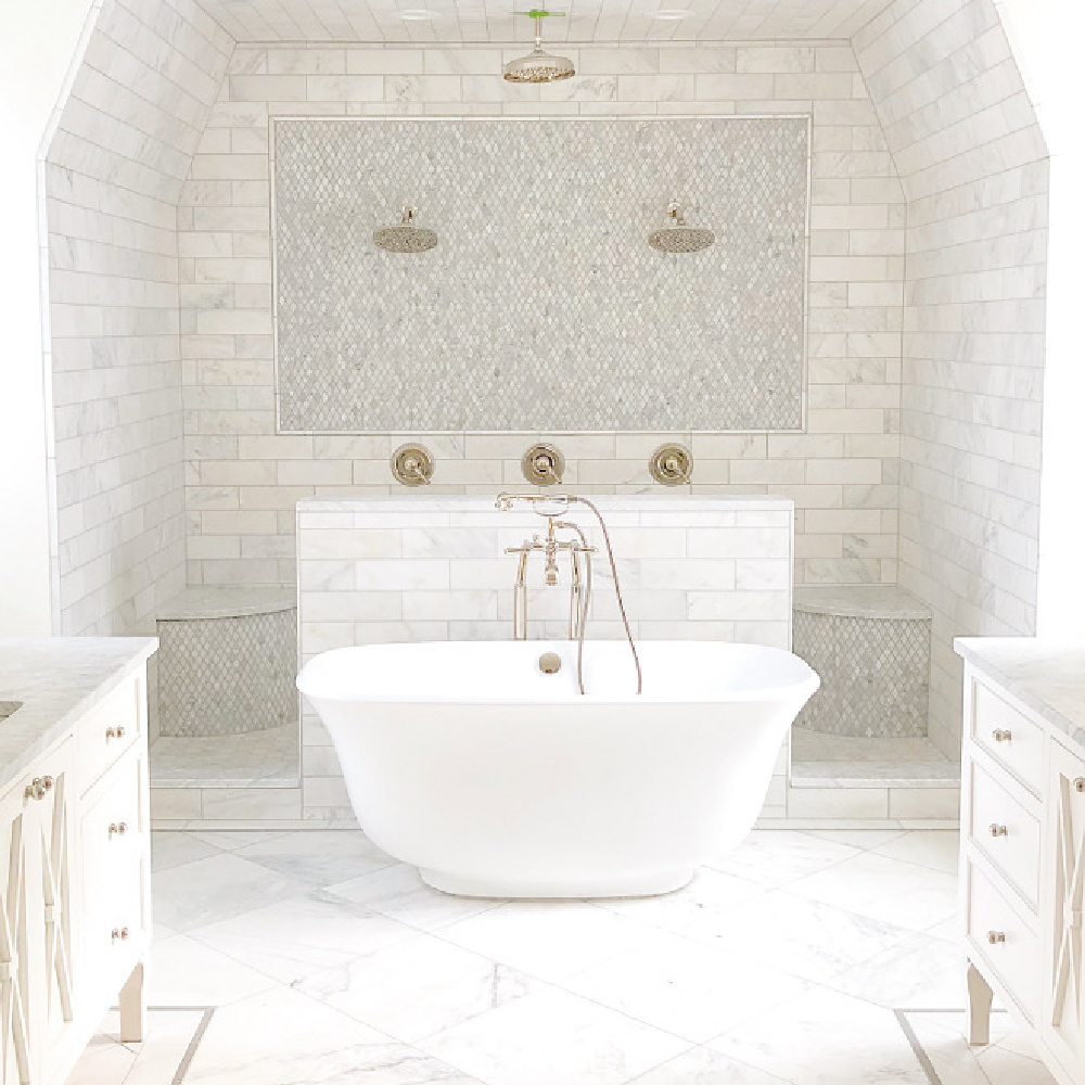 The Fox Group - luxurious white marble bath with double shower with his and hers built in benches. soaker tub, marble subway tile, and unique geometric open design. #bathroomdesign #luxurybathroom #subwaytile #doubleshower