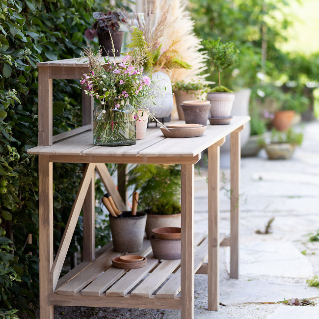 Potting bench with aged terracotta pots from Terrain. Come visit 29 Lovely Feel Good Finds & Funny Quotes!