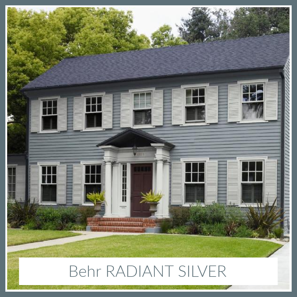 Radiant Silver Behr paint color on a traditional 2-story house exterior with white shutters. #radiantsilver #paintcolors #behrradiantsilver