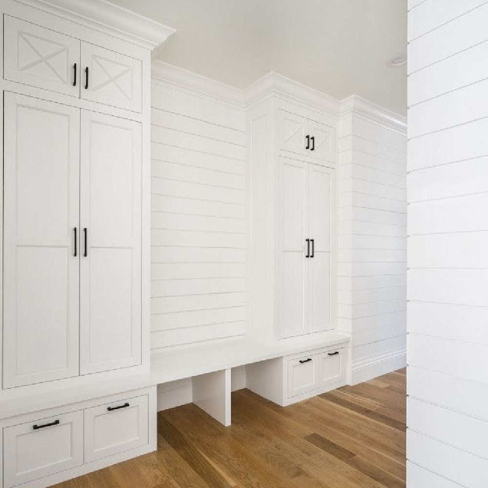 Classic white painted shiplap mud room with custom tall cabinetry flanking bench. Design by The Fox Group. #mudroom #thefoxgoup #shiplap #modernfarmhouse #benjaminmooresimplywhite