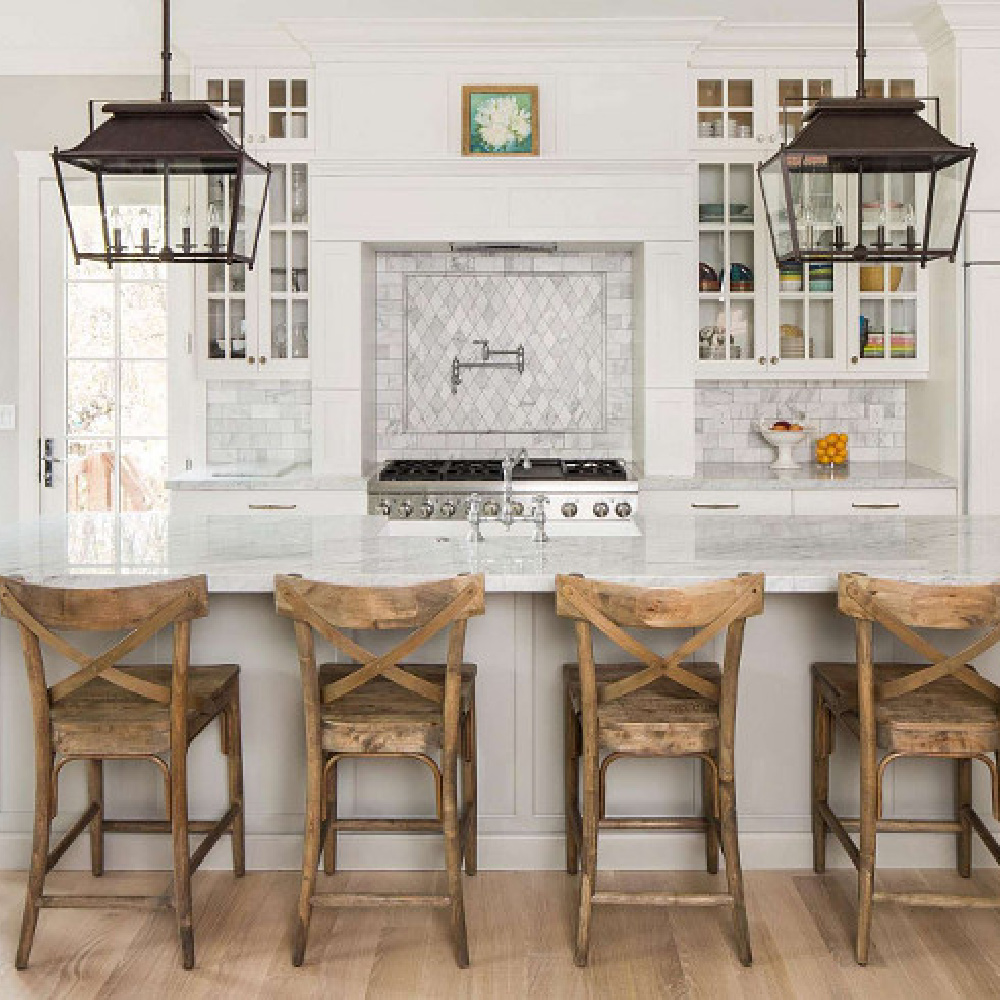 Timeless design in a luxurious kitchen by The Fox Group. Large rustic farmhouse lanterns over island. Timeless Interior Design Ideas, Paint Colors & Furniture Finds! #kitchendesign #farmhouselantern #timelessdesign #thefoxgroup #lanterns