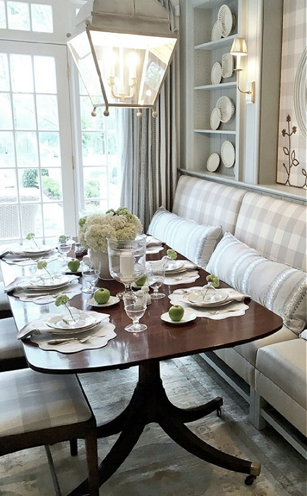 Farrow & Ball Light Blue painted cabinetry in a stunning traditional breakfast dining area in Atlanta. Design by Lauren DeLoach. Antiques and buffalo check fabric by Cowtan & Tout. #traditionalstyle #diningroom #interiordesign #lightblue