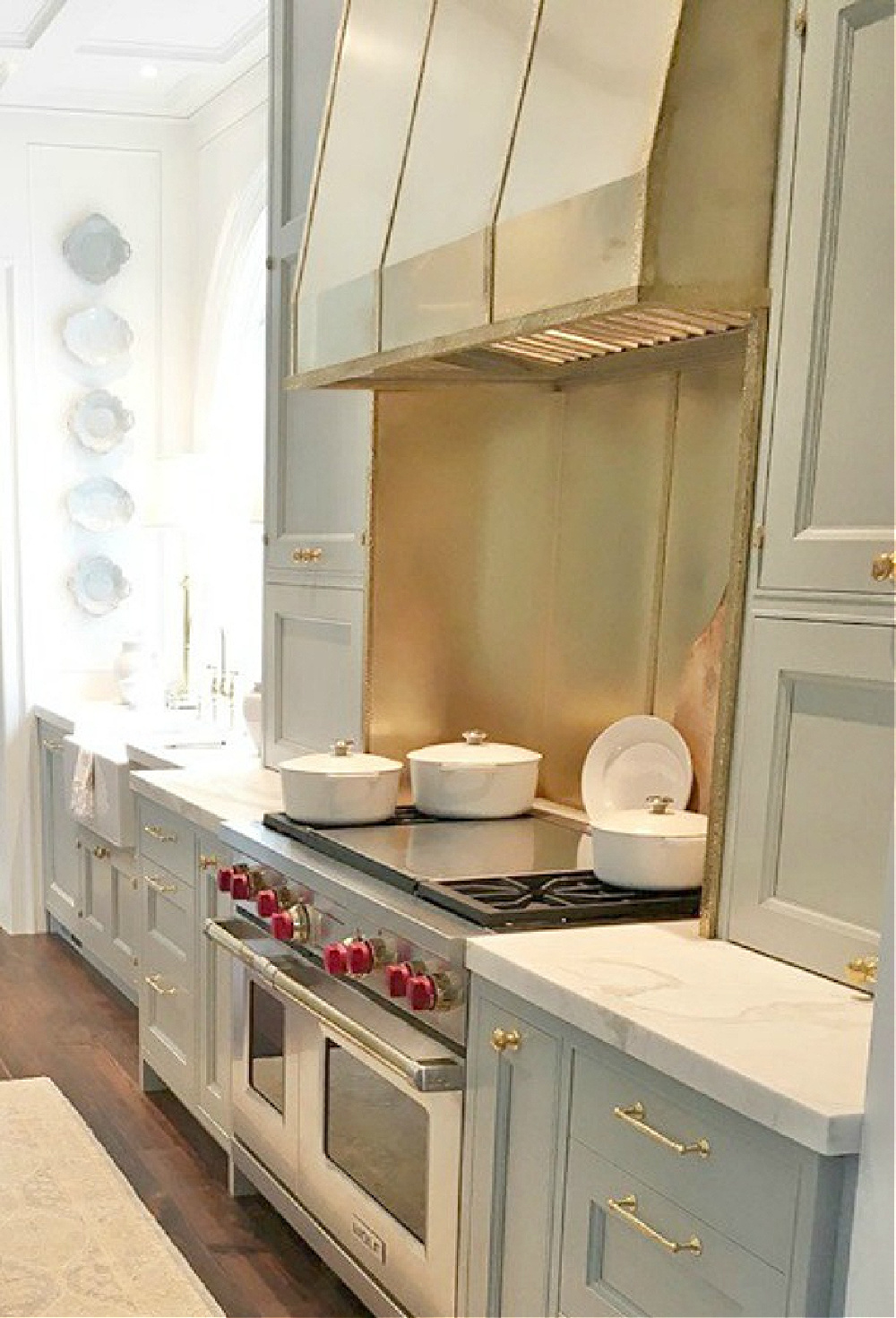 Farrow & Ball Light Blue painted cabinetry in a timeless traditional kitchen in the Southeastern Farrow & Ball Light Blue paint color on cabinets in kitchen. Southeastern Designer Showhouse 2017. #farrowandballlightblue #kitchendesign #bespoke #lightbluepaint #brasshardware
