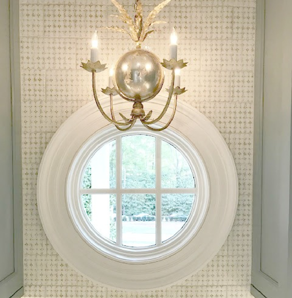 Round window and tile backsplash in blue and white traditional kitchen in Southeastern Designer Showhouse 2017. #kitchendesign #roundwindow #tilebacksplash #traditionalstyle