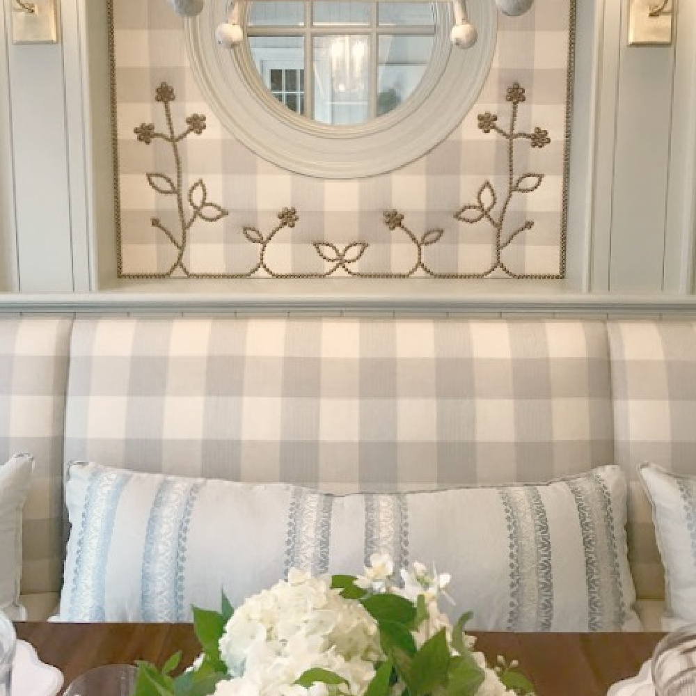 Lovely Cowtan & Tout fabrics in Buffalo check and light blue grace a traditional style dining area in the 2017 Southeastern Designer Showhouse. #diningroom #interiordesign #buffalocheck #traditionalstyle