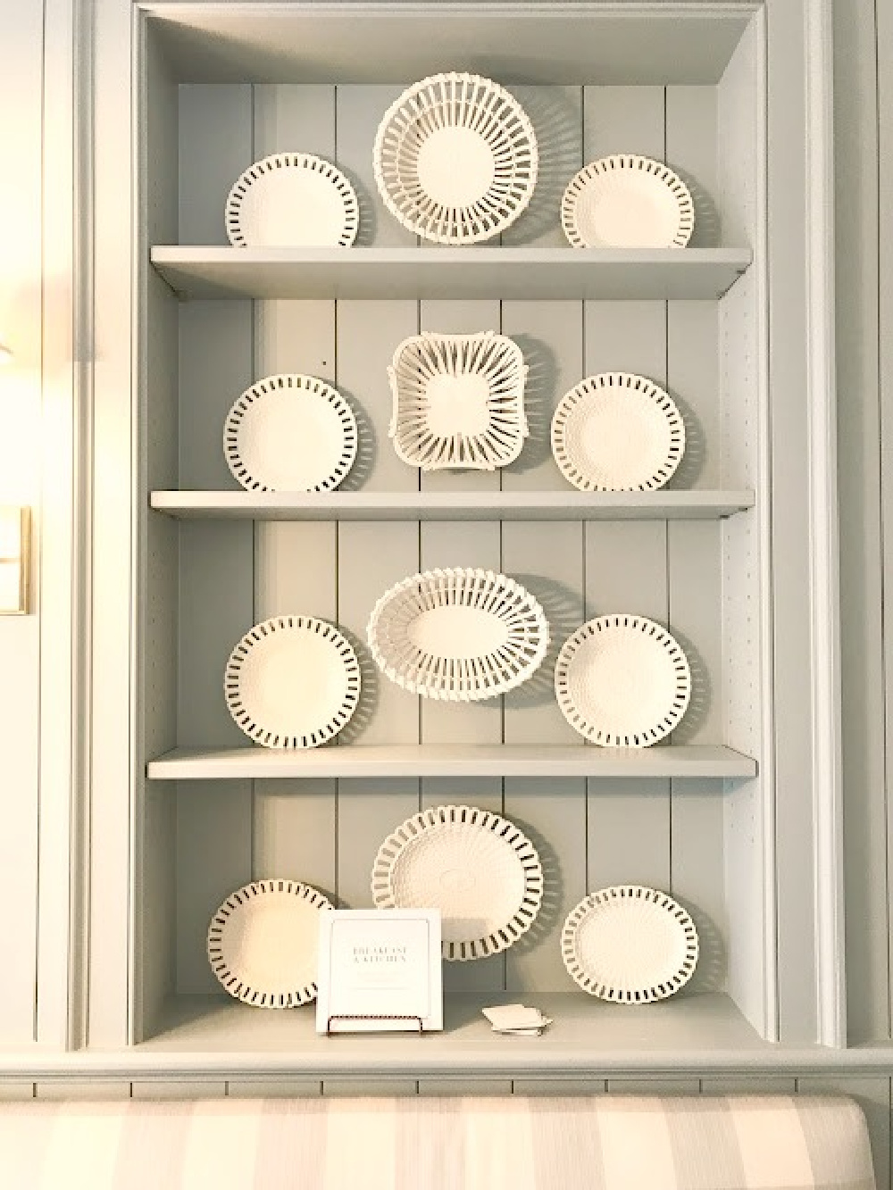 Lace creamware antique plates on blue painted shelves in traditional kitchen at Southeastern Designer Showhouse 2017. #farrowandballlightblue #diningroom #traditionalstyle #interiordesign
