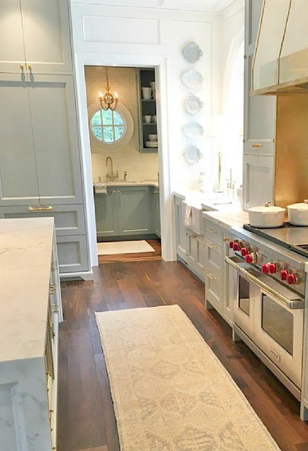 Atlanta Southeastern Designer Showhouse 2017 kitchen with Farrow & Ball Light Blue cabinets and brass hardware.#bluekitchen #farrowandballlightblue #timelesskitchen #kitchendesign #traditionalkitchen