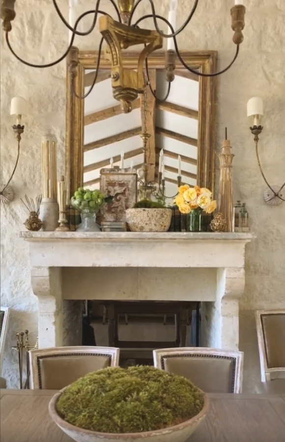 Beautiful antique French mantel and fireplace in Patina Farm's dining room - Velvet and Linen. #patinafarm #frenchfarmhouse #interiordesign #fireplace #giannetti