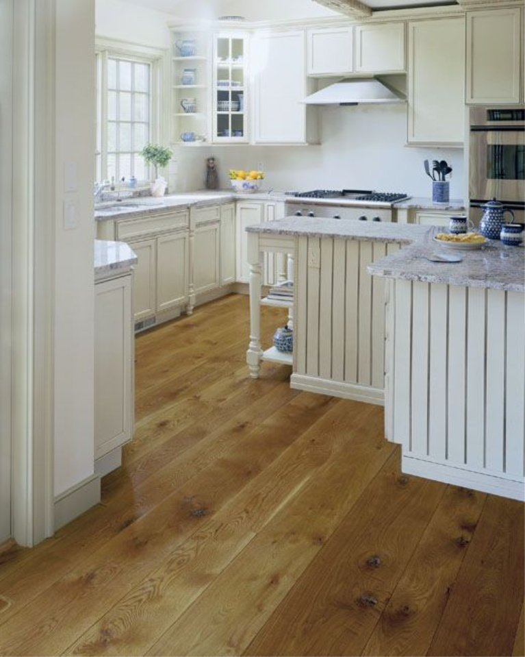 Rustic and warm classic wide plank white oak hardwood flooring in a New England kitchen. #flooring #carlisle #whiteoak #hardwoodfloor #interiordesign #kitchendesign