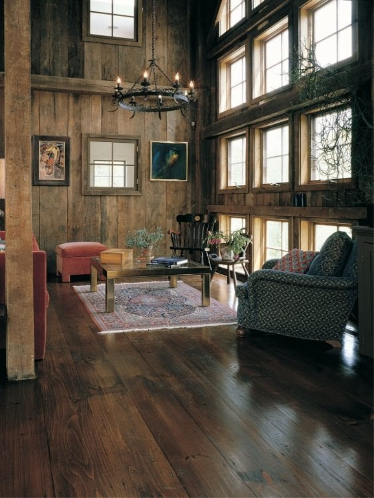 Reclaimed barnwood (Eastern Pine) wide plank flooring by Carlisle in a gorgeous living room with rustic decor. #flooring #hardwoodfloor #wideplankfloor #carlisle #livingroom #pinefloor #interiordesign