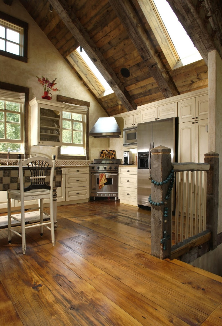 Rustic reclaimed barnwood flooring plays a starring role in this custom Colorado kitchen design. #flooring #hardwoodfloor #reclaimedfloor #barnwood #rusticfloor #carlisle #wideplankfloors #kitchendesign
