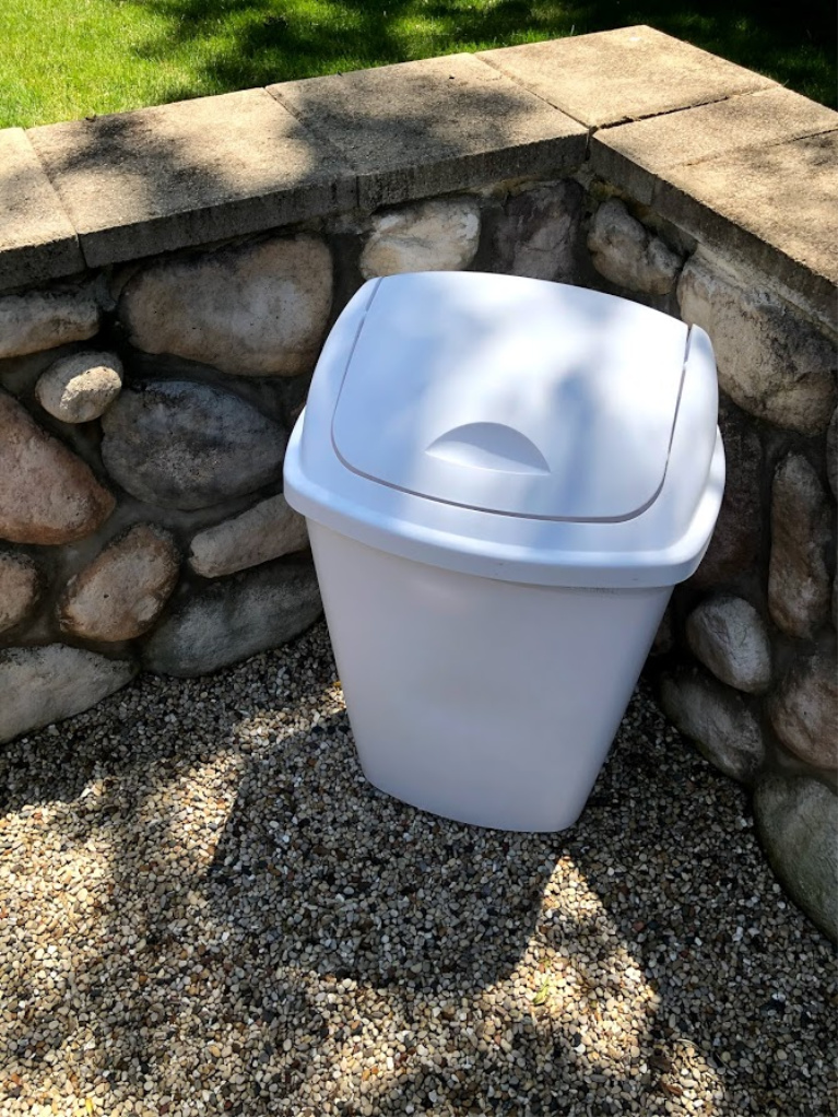 Garbage can in courtyard is not pretty but is essential!