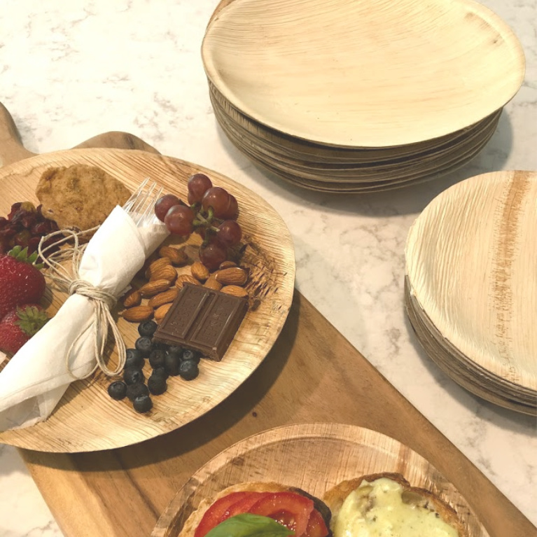 These disposable plates made from palm leaves look like wood and are a perfect choice for summer outdoor entertaining. I used them as mini individual cheese boards and dessert boards - Hello Lovely Studio. #easyentertaining #palmplates #disposableplates #tabledecor #summerentertaining