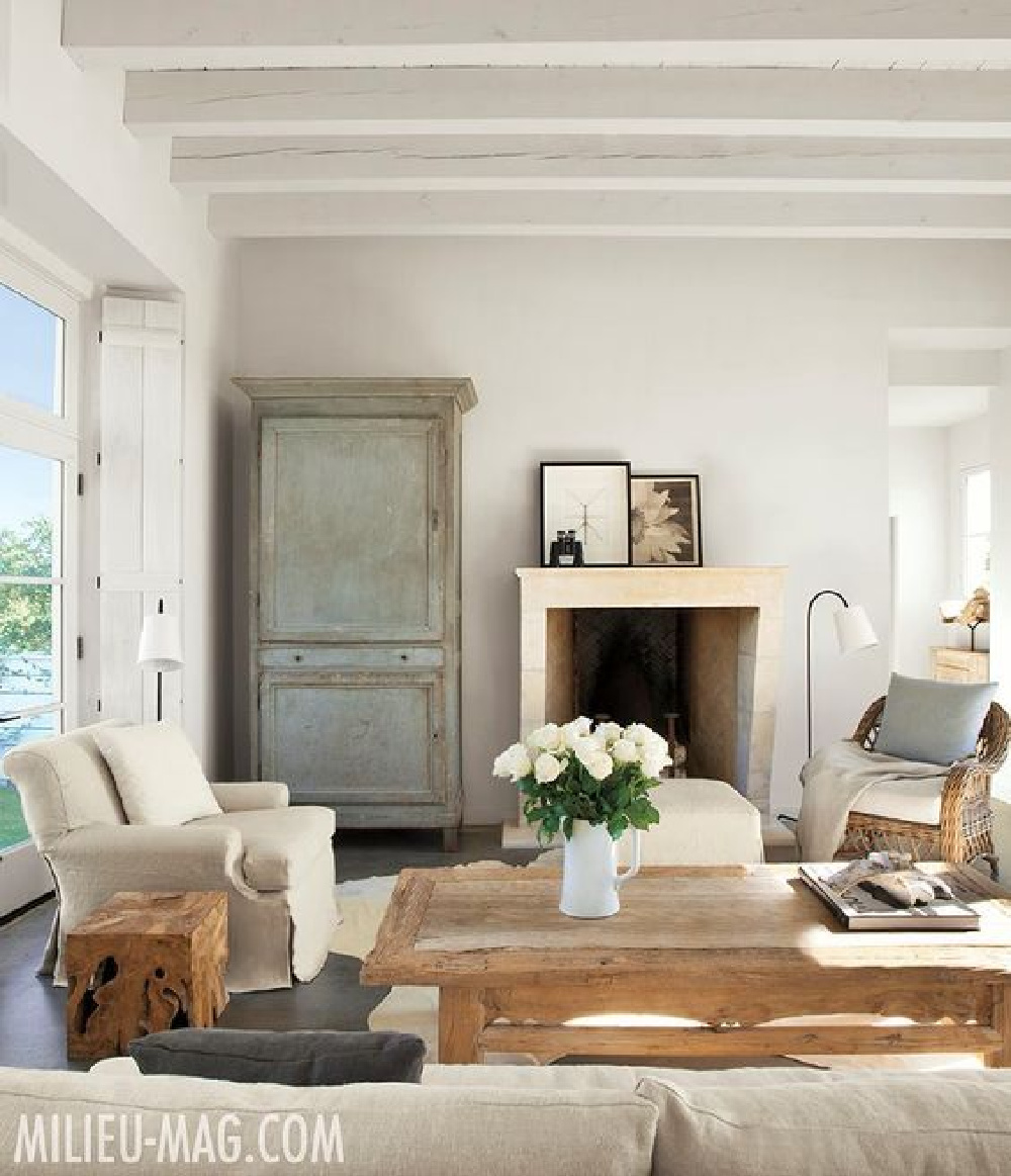 Modern French farmhouse living room by Eleanor Cummings with Swedish antiques and white painted beams - Milieu. #livingroom #modernfrench #frenchfarmhouse #europeancountry #texasfarmhouse