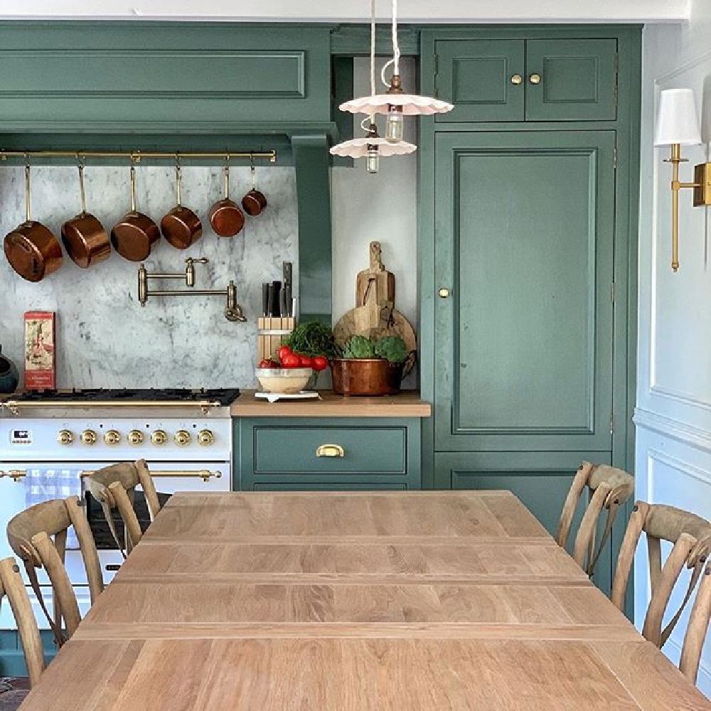 Smoke Green paint (F&B) on French farmhouse kitchen cabinets. Design by Vivi et Margot has a luxurious Ilve range #frenchfarmhouse #smokegreen #paintcolors #frenchkitchen #kitchendesign #farrowandballsmokegreen #greencabinets #ilverange #vivietmargot
