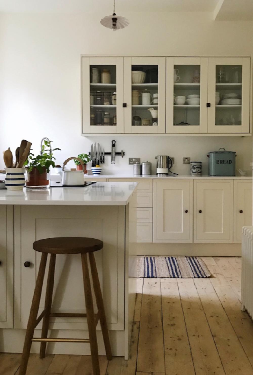 Wimborne White paint color by Farrow & Ball on walls of a glorious country kitchen by Siobhan McFadden of Homestead. #wimbornewhite #farrowandball #paintcolors #englishcountry #kitchendesign #whitepaintcolors #interiordesign