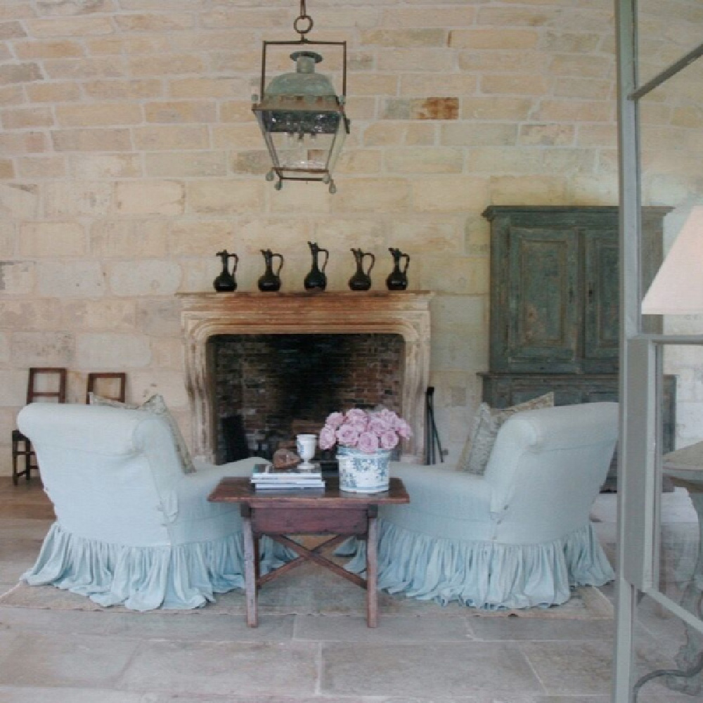 18th century French doors, barrel vaulted ceiling clad in 17th century stone from a French Vineyard, and blissful upholstered chairs with ruffle slipcovers grace Ruth Gay's office. Come tour more of this spectacular home!