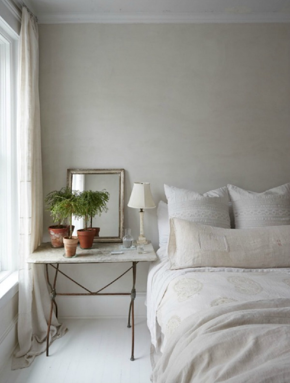 Serene bedroom with European rustic elegance looks as though it might be in the South of France, not New York...see more lovely examples of European farmhouse decor you can bring to your own spaces at home. #Europeanfarmhouse #elegantdecor #countrystyle