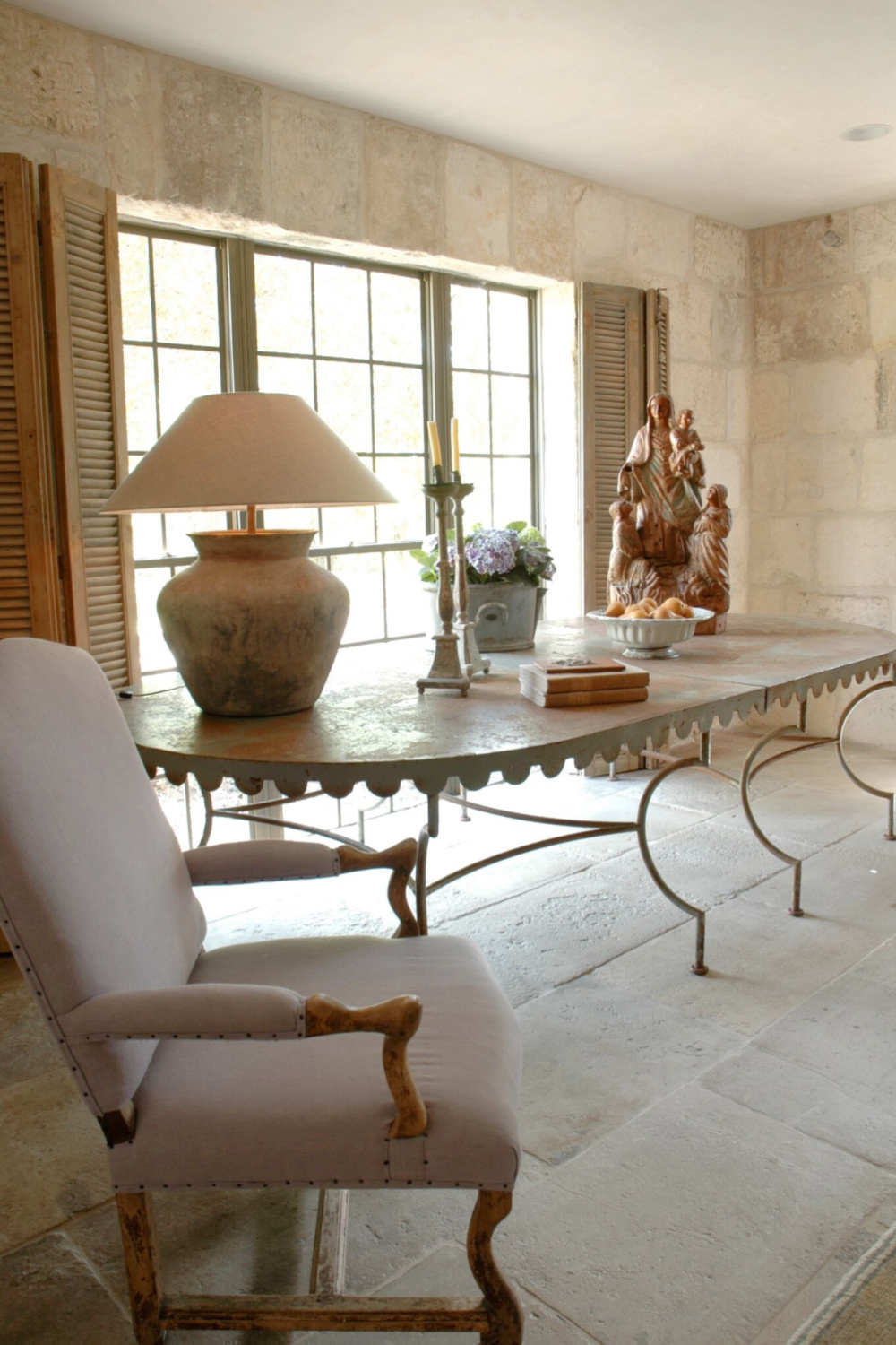 Country French romance, authenticity, and aged beauty in this interior from Chateau Domingue. #stonewalls #countryfrench #oldworldstyle