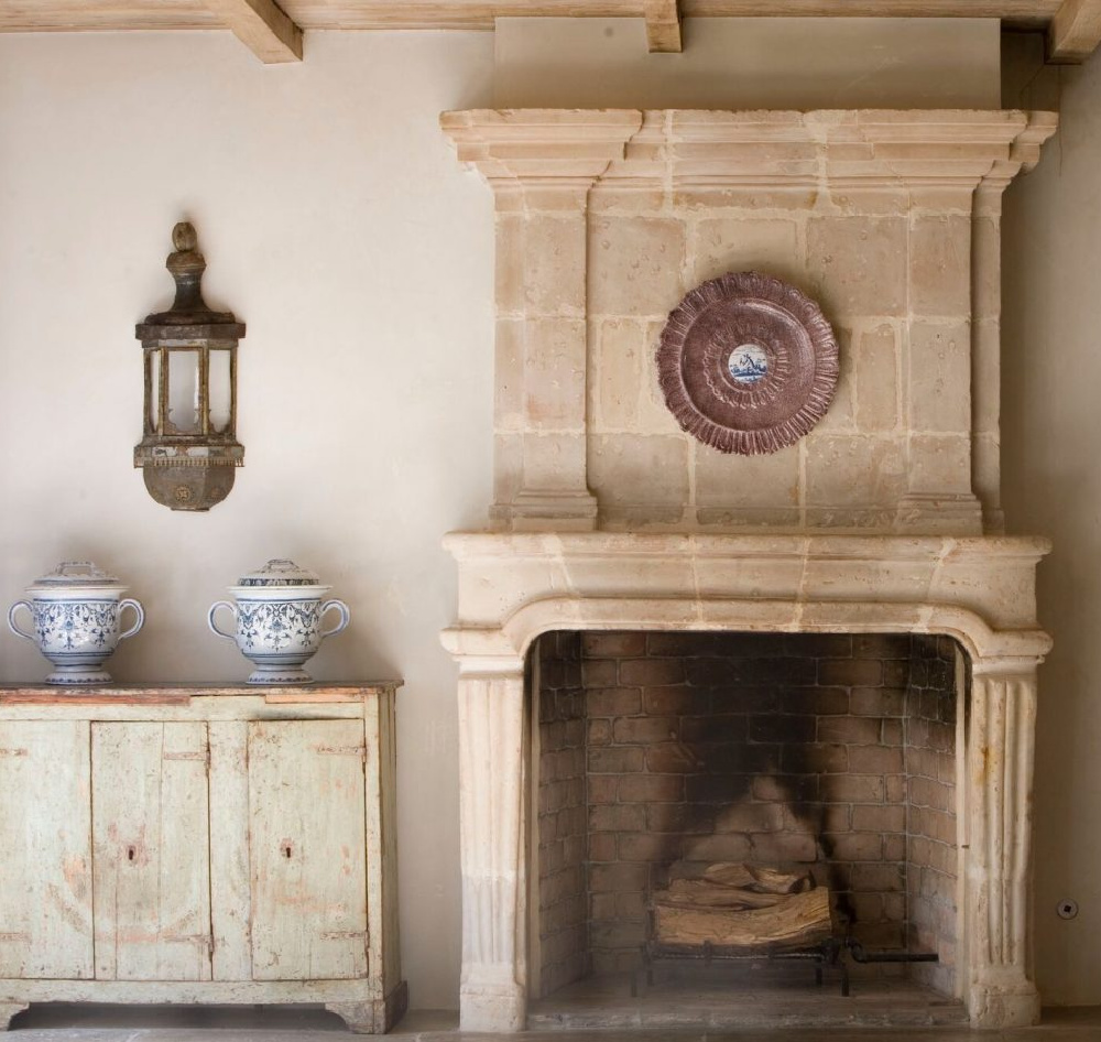 Magnificent antique French limestone fireplace and European country treasures from Chateau Domingue in the exquisite home of Ruth Gay.