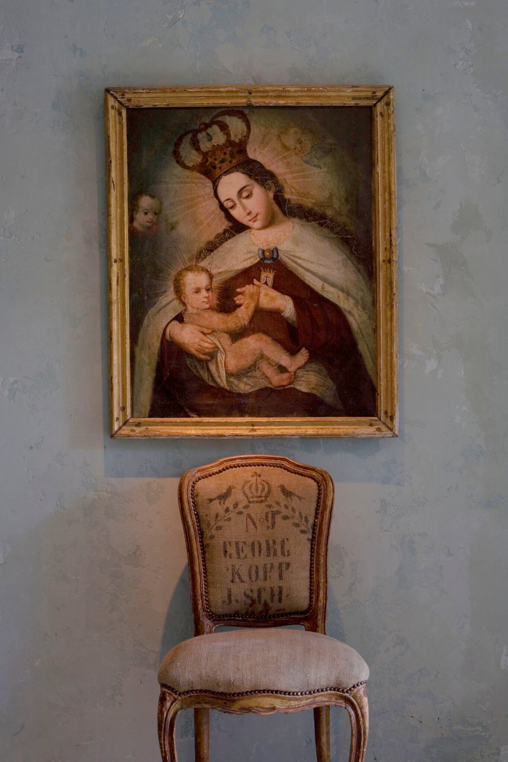 Beautiful antique religious art from France with elegant chair upholstered in gransack - Chateau Domingue.