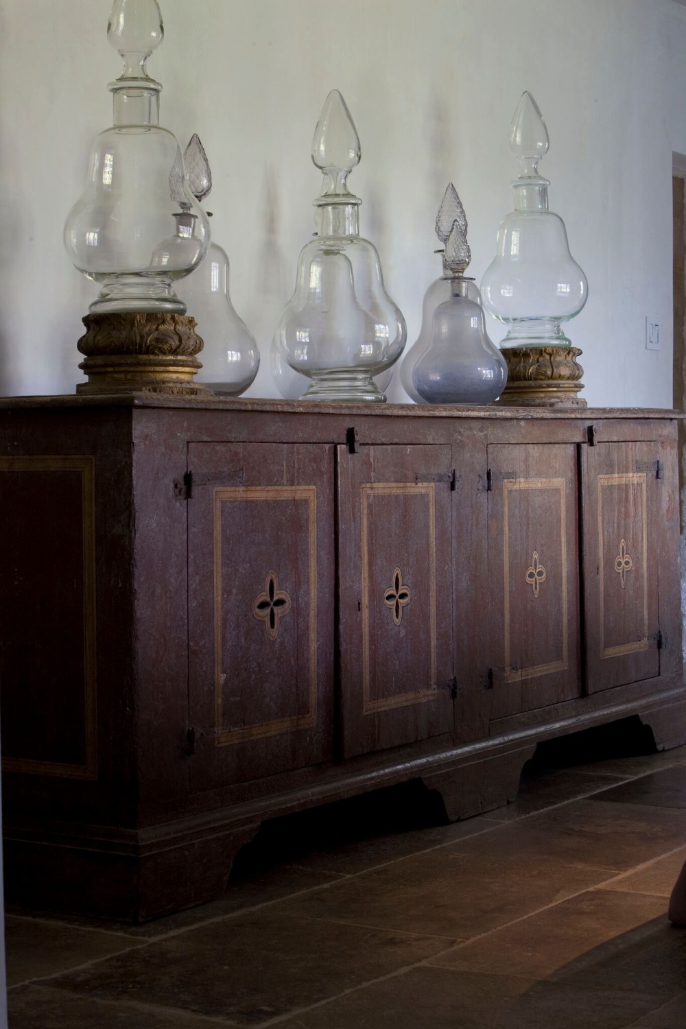 Magnificent antique rustic wood sideboard and treasures from Europe in Ruth Gay's elegant dining room (Chateau Domingue).