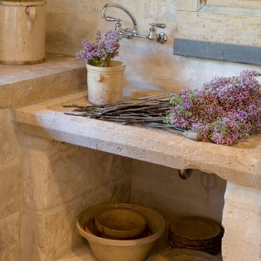 Warm rugged antique stone sink in a beautiful country French kitchen - Chateau Domingue.