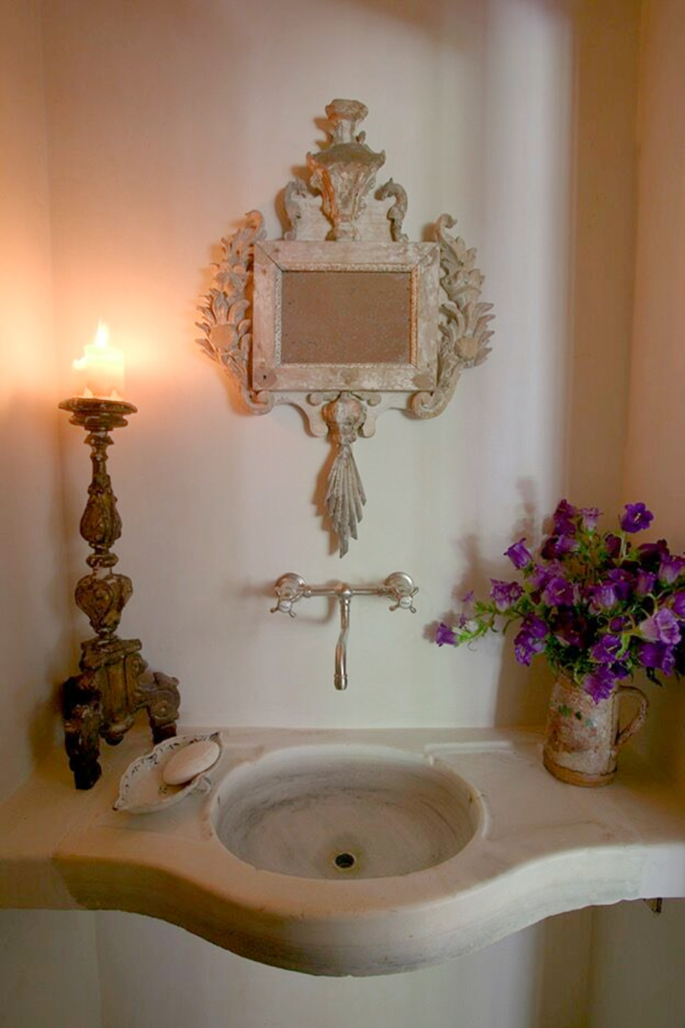 Authentic country French bath with antique stone sink and wall mount faucet - in Ruth Gay's (Chateau Domingue) home. Come tour more of the exquisite interiors!