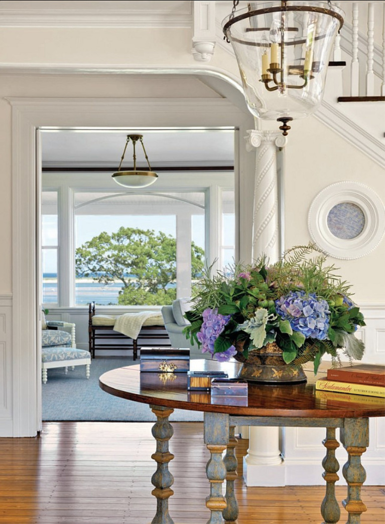 Maritime White (Benjamin Moore) paint color on the walls of a coastal style entry in a luxurious traditional home - Kotzen Interiors). #paintcolors #benjaminmooremaritimewhite #maritimewhite #interiordesign #coastalstyle #entry