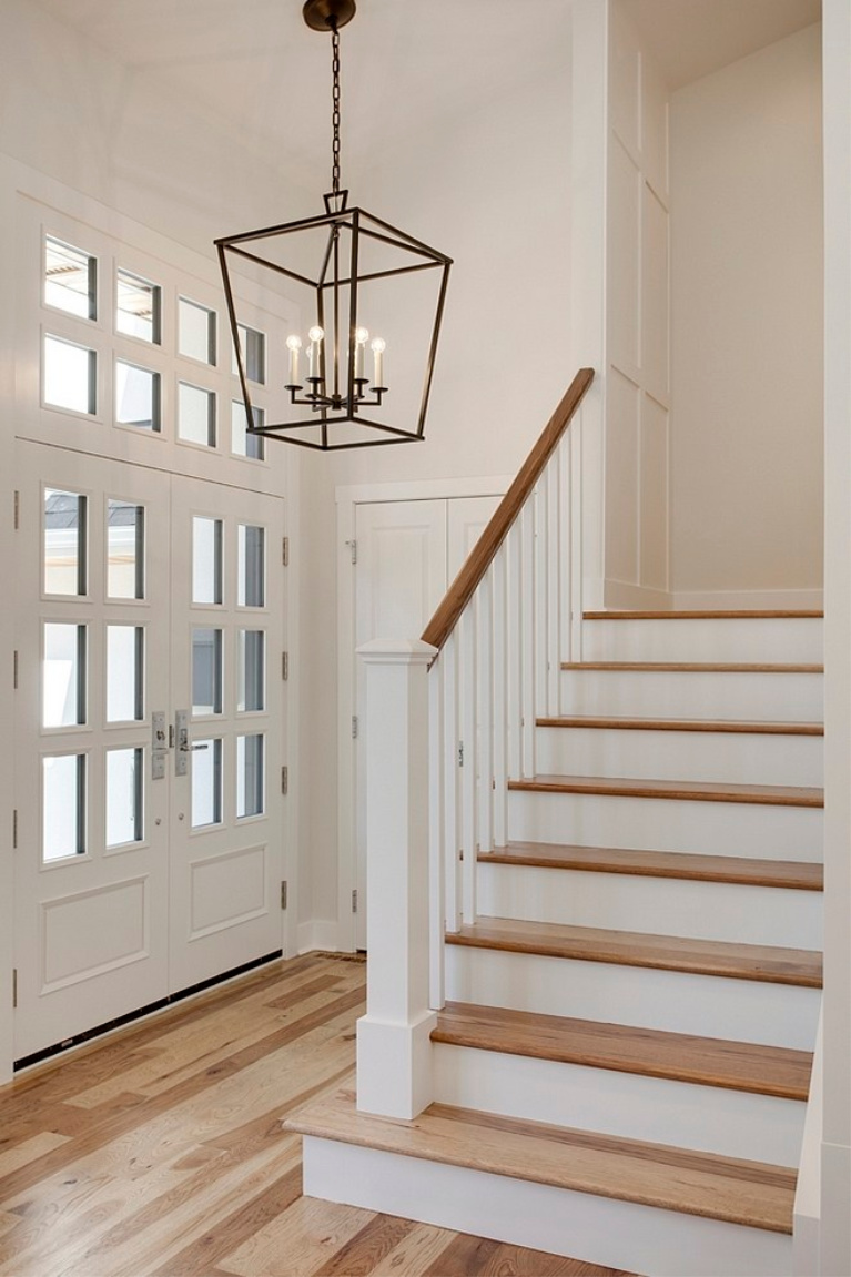 Seapearl white paint color from Benjamin Moore on the walls of an entry in a modern farmhouse by Veranda Estate Homes. #seapearl #benjaminmooreseapearl #paintcolors #interiordesign #entry #modernfarmhouse