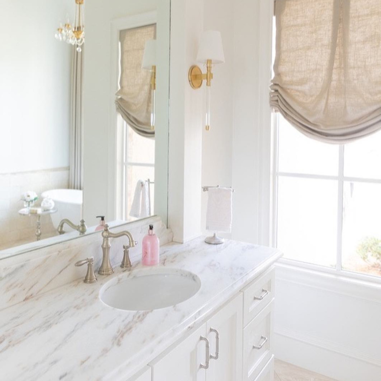 Elegant and sophisticated French country bathroom with romantic decor - Brit Jones. #bathroomdesign #frenchcountry #romanticdecor #serenedecor #interiordesign