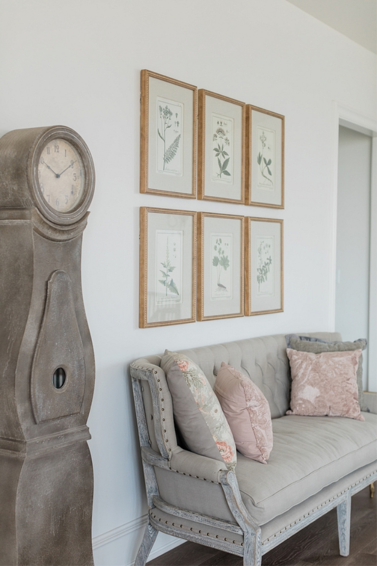 French country landing with settee, botanical prints and grandfather clock - Brit Jones. #interiordesign #frenchcountry #settee #botanicalprints #romanticdecor #oldworld