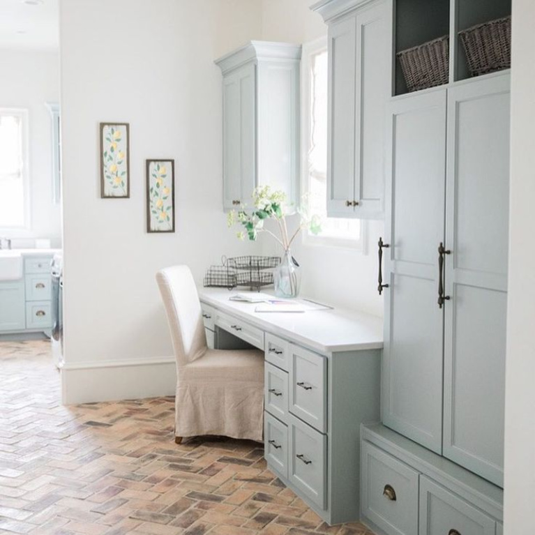 Silver  Mist (Sherwin Williams) paint color on cabinets in a lovely French country laundry room mud room by Brit Jones Design. #laundryroom #frenchcountry #brickflooring #herringbone #bluegrey #silvermist #sherwinwilliamssilvermist #paintcolors