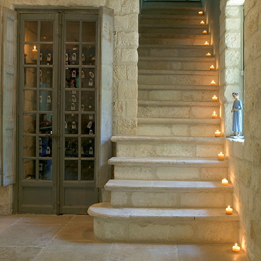 Antique French limestone staircase - Chateau Domingue Timeless European Elegance and French farmhouse style converge in this house tour of founder Ruth Gay's home on Hello Lovely. Reclaimed stone, antique doors and mantels, and one of a kind architectural elements. #housetour #frenchcountry #frenchfarmhouse #europeanfarmhouse #chateaudomingue #rusticdecor #pamelapierce #elegantdecor
