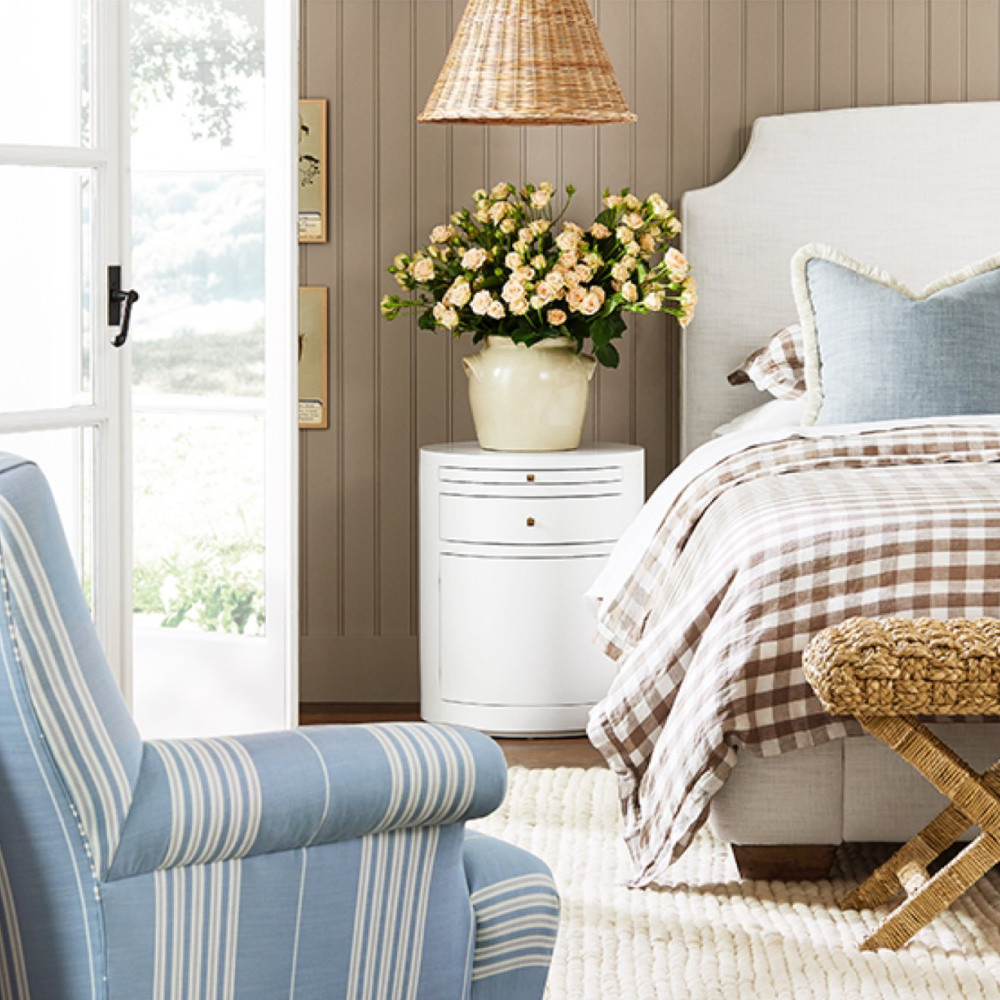 Coastal bedroom with neutrals, beadboard, gingham, stripe chair, chambray blue accents and French confit jar with roses - Serena & Lily. #coastalbedroom #neutralbedroom #sophisticatedbedroom