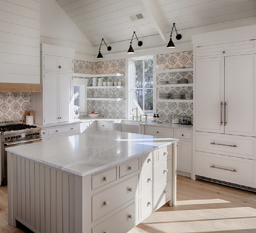 Benjamin Moore Pashmina paint color on island in a coastal kitchen with Shaker cabinets, shiplap, encaustic tile backsplash and white oak flooring. White paint is BM White OC-151. Design by Lisa Furey.