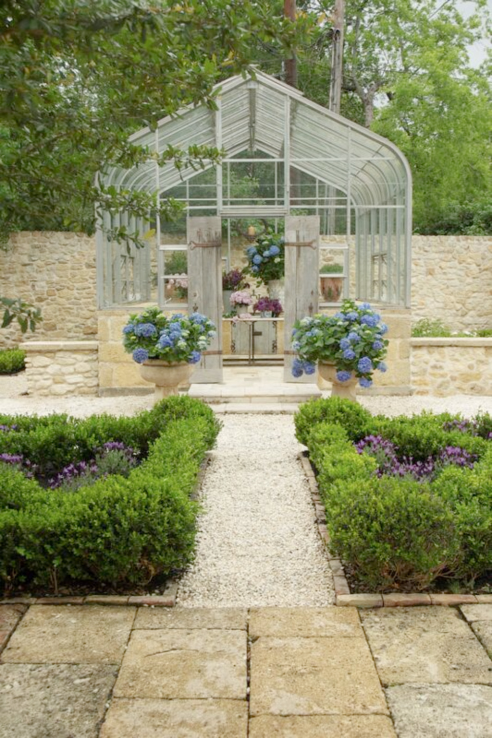 Exquisite French garden with conservatory and reclaimed stone from France - Chateau Domingue. #frenchgardens #conservatory