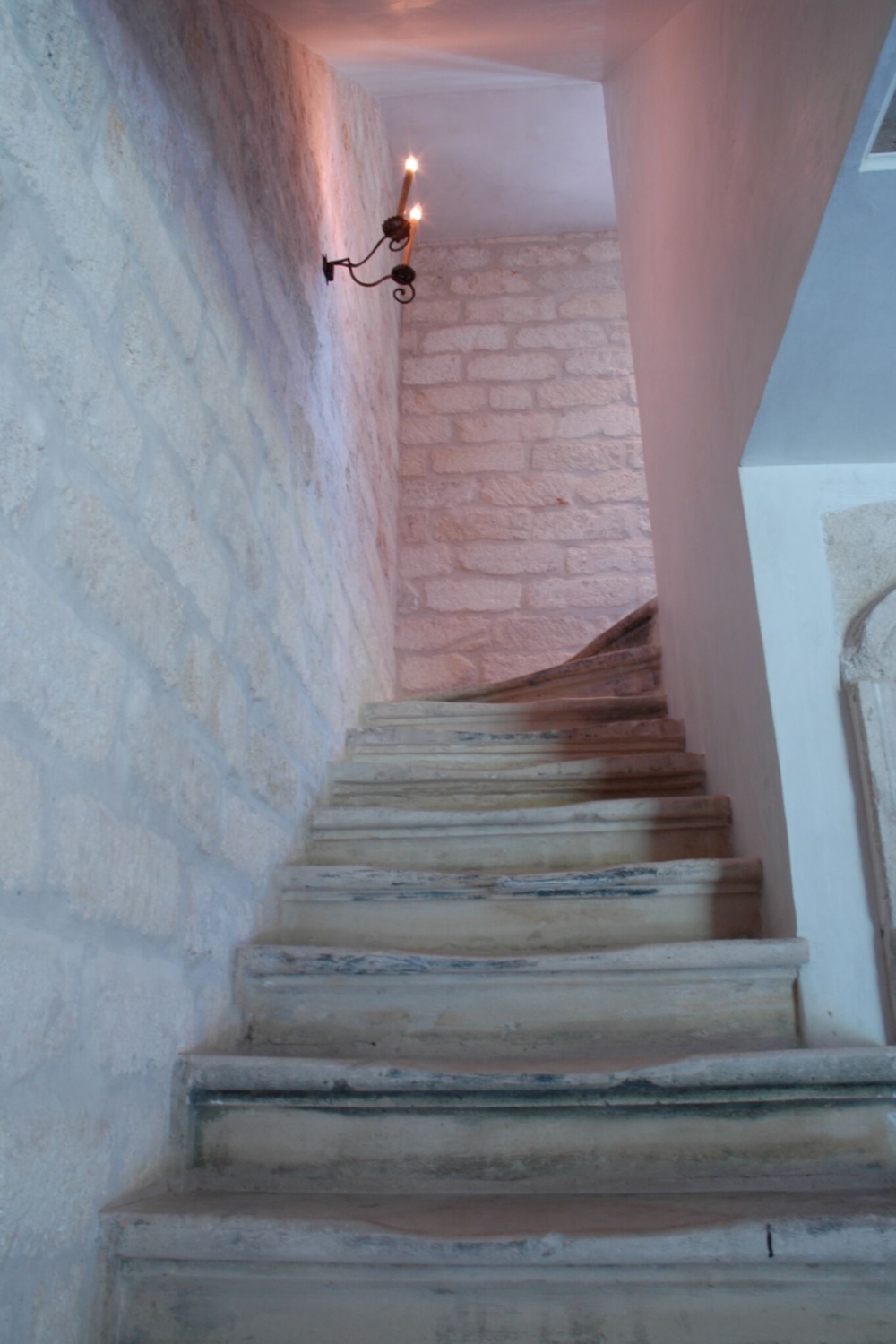 Detail of the rustic elegant staircase in Ruth Gay's home - Chateau Domingue.